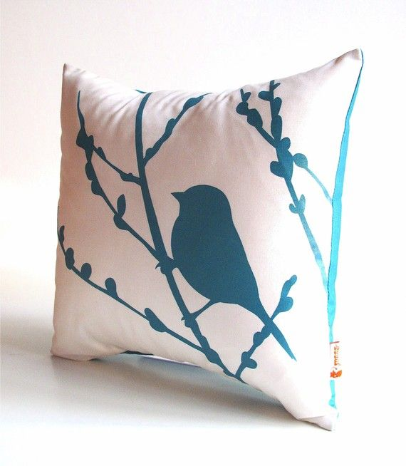 White throw pillow with teal bird and branches. I've been looking to update my pillows and for something to do with my leftover fabric paint. I could paint something like this. Hmm...