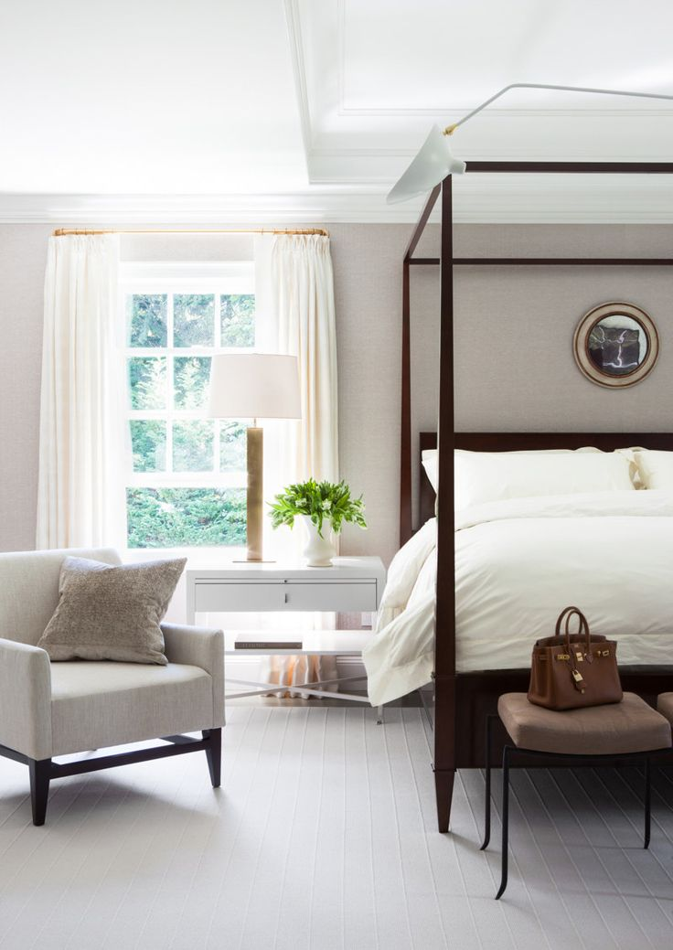 In the master suite, the four-poster bed adds an elegance to the minimal decor.