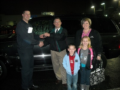 Folger Subaru Internet Sales Consultant New Howie with the Carol family and their 2004 GMC Yukon SUV!