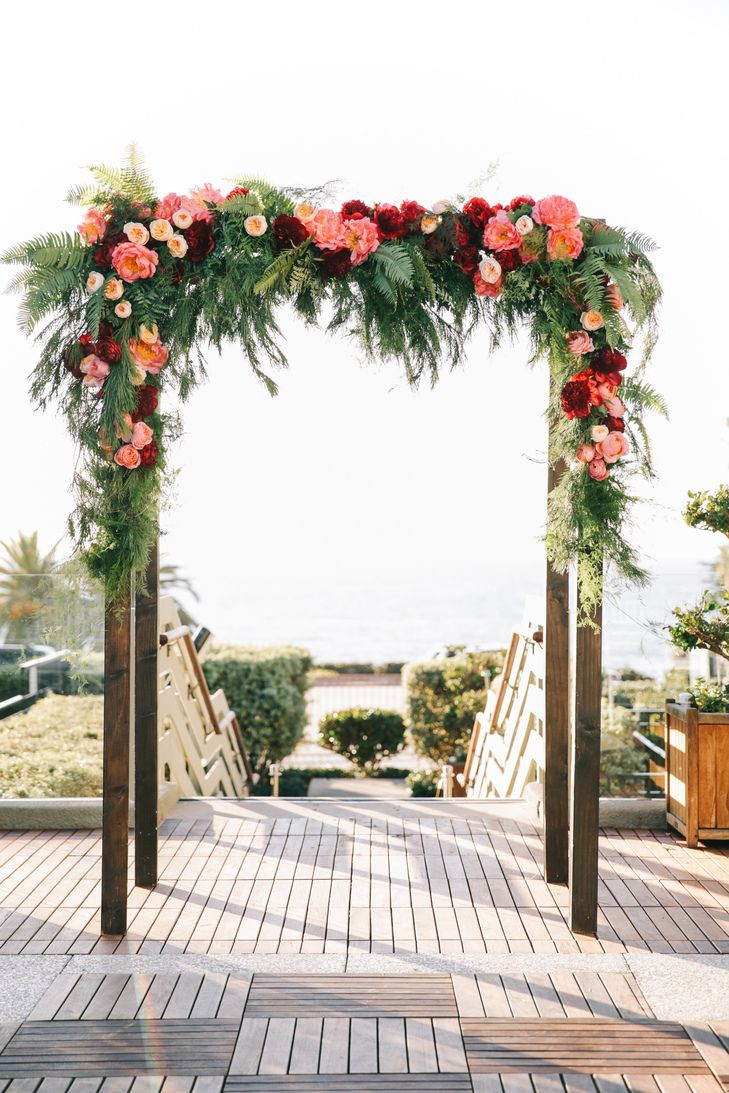 Burgundy and Pink Floral Arch with Garden Roses | Oak and the Owl | Amorology | Brandon Kidd Photography https://www.theknot.com/marketplace/brandon-kidd-photography-yorba-linda-ca-477873
