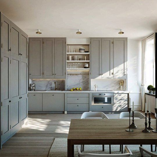 Swedish Kitchen with Gray Painted Cabinets & Marble Backsplash - note the cabinet 'feet'