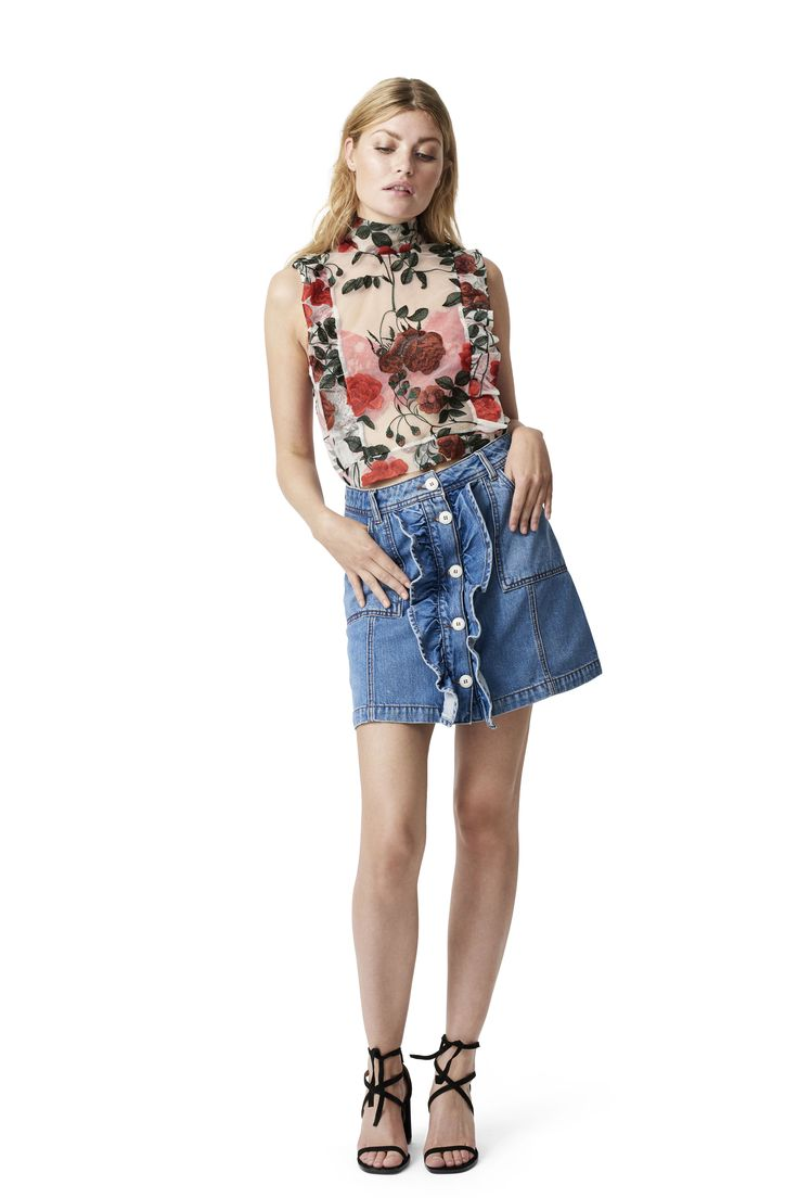 Lightweight denim skirt with front pockets, frill  details and button placket.  <br /><br />Model is 175cm tall and wearing a size small/  36.