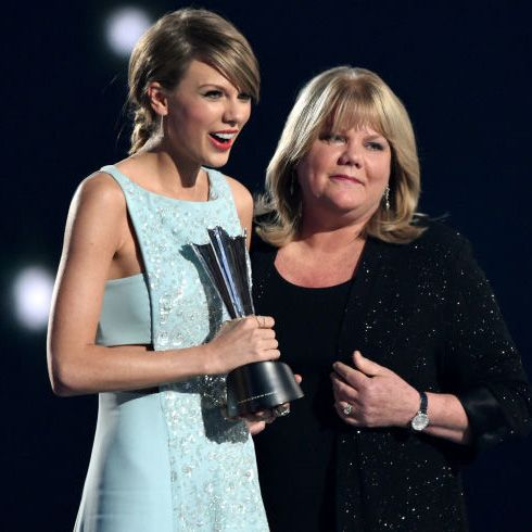 Taylor Swift is presented her AMC Award by her mother, Andrea. Watch the emotional moment here: