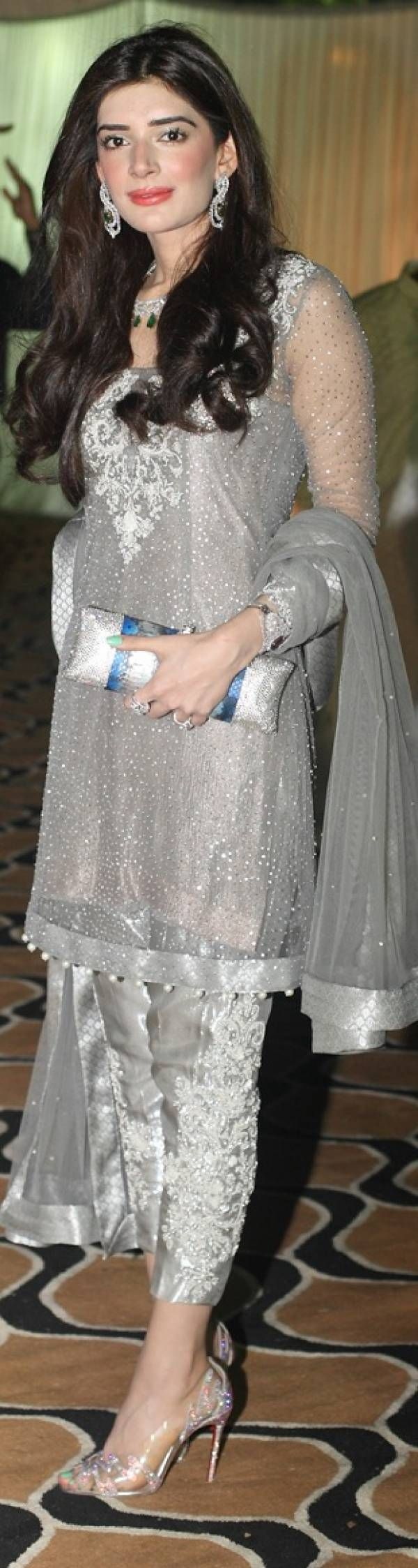The Mischa Barton lookalike looks elegant as ever in a silver Elan outfit, accessorized with stunning bling and en trend transparent Loubs.