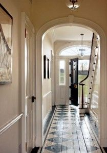 Classical moldings and a painted floor add authenticity. #1928