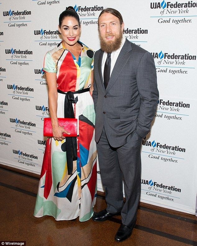 Baby on the way: Total Bellas star Brie Bella announced that she and her husband Daniel Bryan (pictured last year) are expecting their first child together in the spring