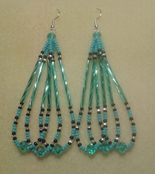 Contemporary Native American beaded earrings, Digital Pines Market.  Light blue and black seed beads, silver cut-glass beads, light blue twisted bugle beads, large light blue cut-glass accent beads.