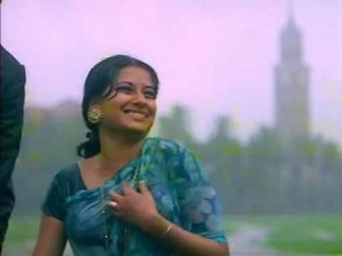 A treasure I just chanced upon. I always knew the song but never that it was in the movie.  What a wonderful way to picturize this - this is SO totally MY kind of romance :). Walking in the rain, holding hands and not caring one bit about getting wet. Just boundless freedom and love. Song: Rim Jhim Gire Saawan Movie: Manzil Singer: Lata Mangeshkar