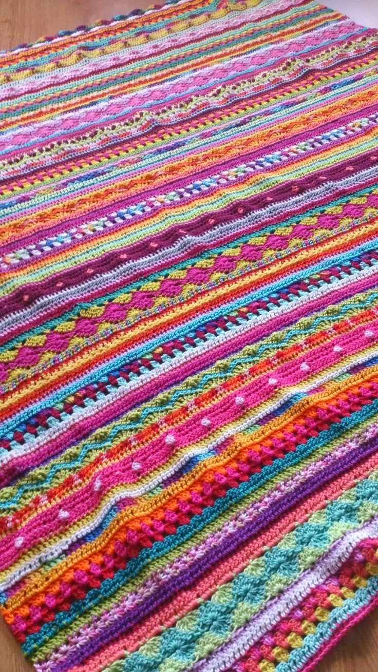 What a gorgeous crochet blanket - so bright and happy! And so unlike anything I've seen before, too.