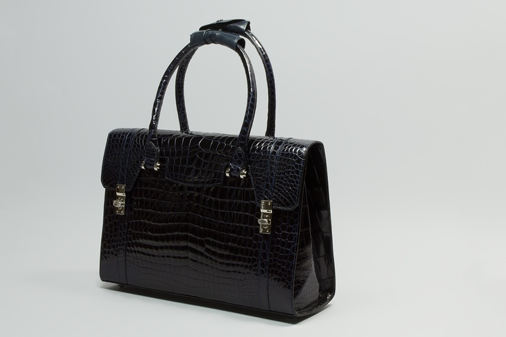 MARZIA     Elegant bag, side locks  and double handle
