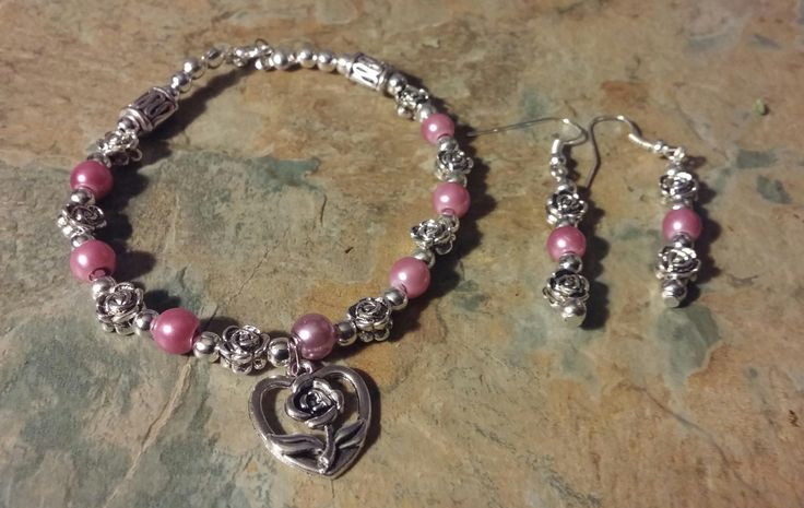 A beautiful silver roses with lilac pearl bead detail handmade bracelet with silver lobster clasp with matching earrings by SpryHandcrafted on Etsy