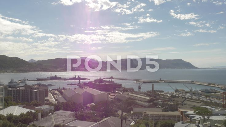 4k Beautiful Blue Water Ocean Mountains Pier Naval Dockyard Sunny Lens Flare - Stock Footage | by RyanJonesFilms