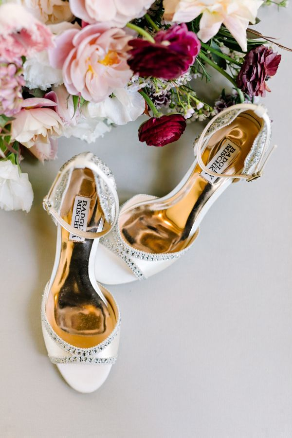 Ivory embellished Badgley Mischka stilettos: http://www.stylemepretty.com/texas-weddings/buda-texas/2016/12/19/rustic-elegant-texas-wedding-full-of-love/ Photography: Julie Wilhite - http://juliewilhite.com/