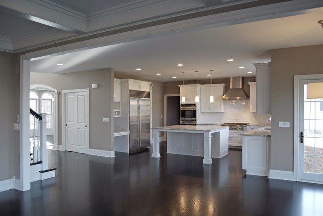Dark counter tops taupe walls white cabinets and trim stainless steel accents yep this is the idea. Very nice