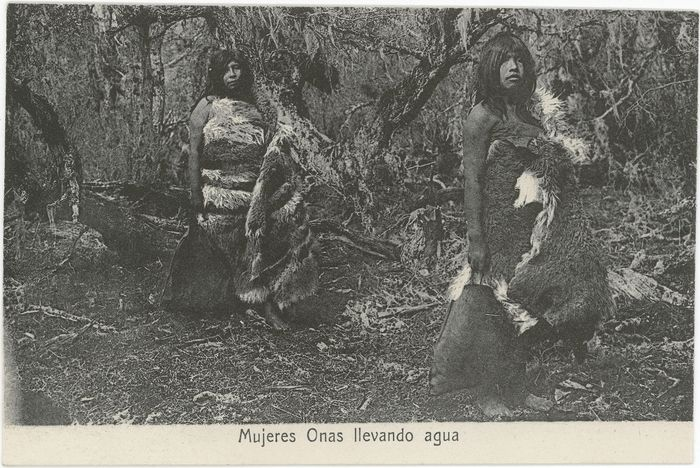 Title:  Mujeres Onas llevando agua Description:  Two Selk'nam women wearing guanaco robes, carrying hide containers of water through a wooded area Culture/People:  Selk'nam (Ona) Date created:  circa 1930 Photographer:  Father Alberto Maria De Agostini, Non-Indian, 1893-1960