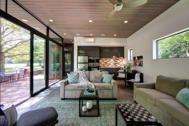 """The 480-square-foot home consists of a """"great room"""" that holds the kitchen, dinging and living room. The home also has a full bathroom, plenty of storage, and a deck with stunning views of the lake."""