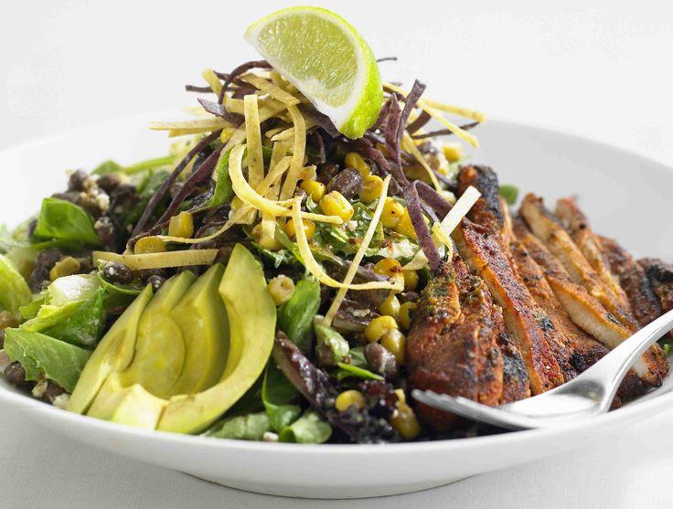 Earls - Santa Fe Chicken Salad avocado, black beans, corn, dates and organic greens, peanut lime vinaigrette, crispy tortillas, half breast cajun spiced chicken