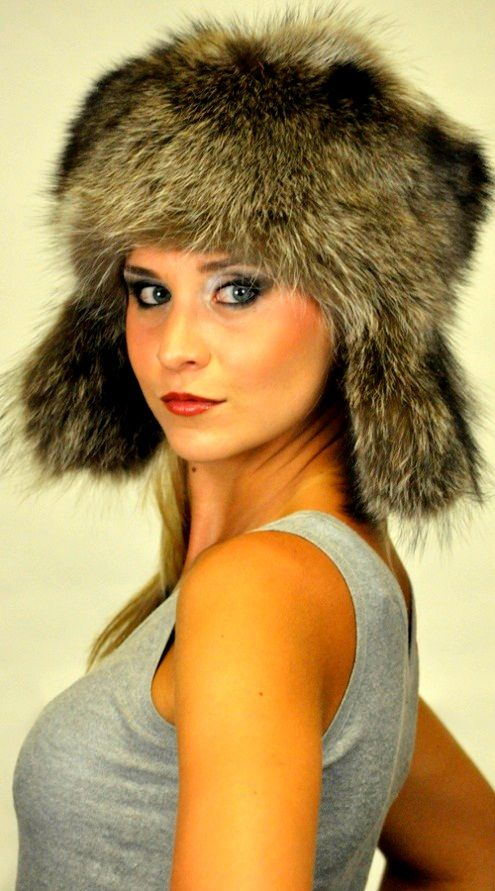 Raccoon fur hat, Ushanka. For women and men wishing to be trendy and flaunt their own style even in cold winter. This  hat is soft, warm and high quality. Fur on both sides of ear flaps. Made in Italy.  www.amifur.com