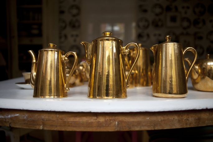 Tea with textile artist Alice Kettle and her glorious collection of golden tea-sets. Photography by Marina Loram. Styling by Poppy Koumis. http://thevillaofthebirds.com/portfolio/tea-with-alice-kettle/