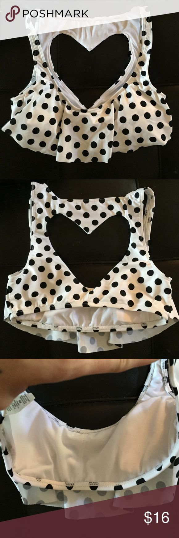 Heart polka dot kini top sz M bikini Lab black and white polka dot bikini top size medium lined and padded lightly top rufly along the front and has a gorgeous Heart Cut OUT along the top of your back if your going to have tan lines having a Tan HEART on the top of your back would be the CUTEST TAN LINES EVER! Can match with white black or any colorful bottoms because it's black and white! Didn't fit my DD so brand new never worn great quality materials made from Bikini Lab! Offers welcome…