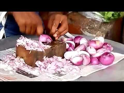 Indian street boy cuts onion faster than a machine (unbelievable video)\Must watch