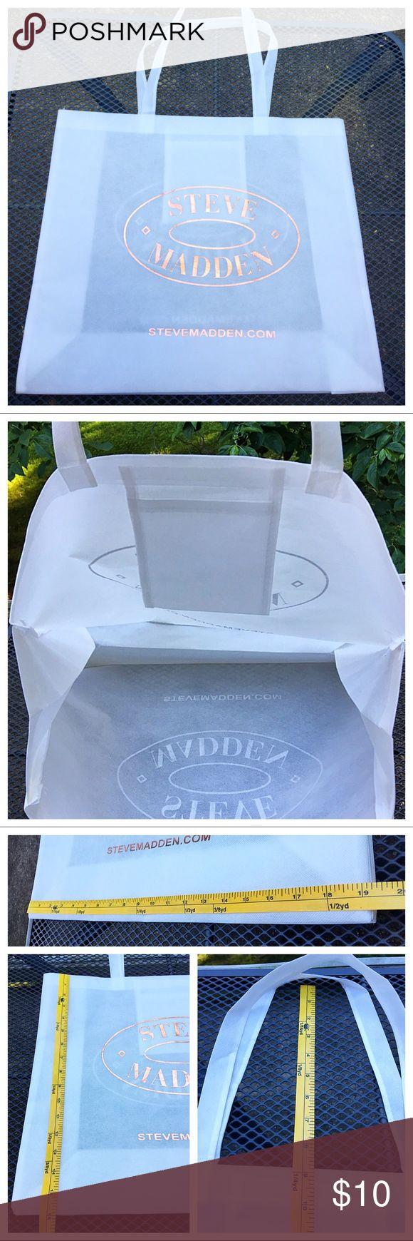 Steve Madden Large Cloth Shopping Bag White cloth shopping bag by Steve Madden! Used only once to bring home toddies from the store! White with gold lettering. 1 small interior slip pocket. Steve Madden Bags Totes