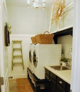 a well organized laundry room. I wonder how they got the storage UNDER the washer and dryer?