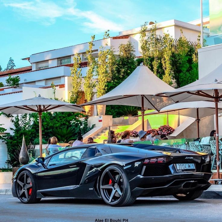 Lamborghini Aventador Roadster painted in Nero Aldebaran w/ a set of aftermarket wheels  Photo taken by: @alaeelbouhi on Instagram