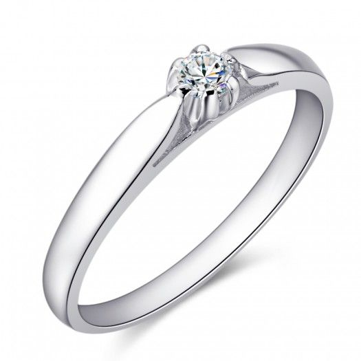 Piękny diament otoczony białym złotem...