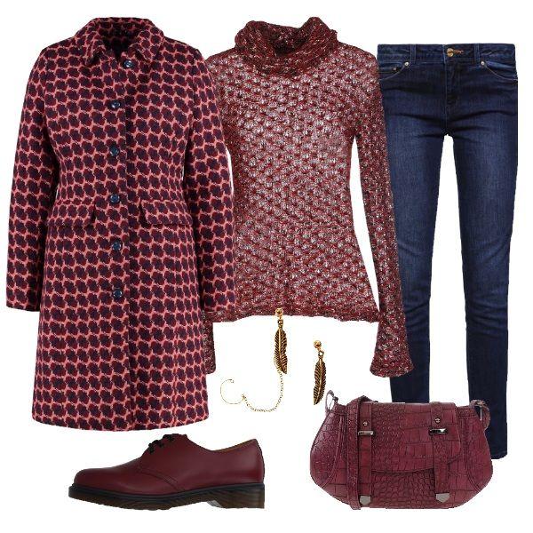 Il jeans scuro diritto è abbinato al maglione bouclé nei toni del burgundy, Il medesimo colore è richiamato nella borsa stampata cocco e nelle dr martens basse. Punto forte di questo completo è il cappotto dai vivaci colori invernali che dona un tocco di originalità al tutto. Orecchini moderni per finire.