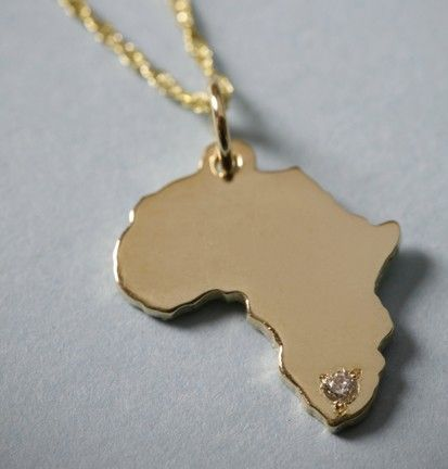 14K Solid Gold Africa Pendant or Charm with Diamond. $250.00, via Etsy.