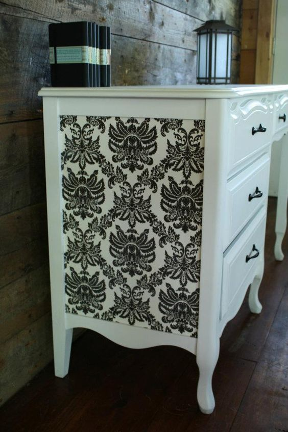 I have my grandfather's old dresser...I might paint it black, do this on the side, and paint the inside of the drawers the baby pink color :):