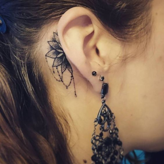 Cute behind the ear mandala tattoo.