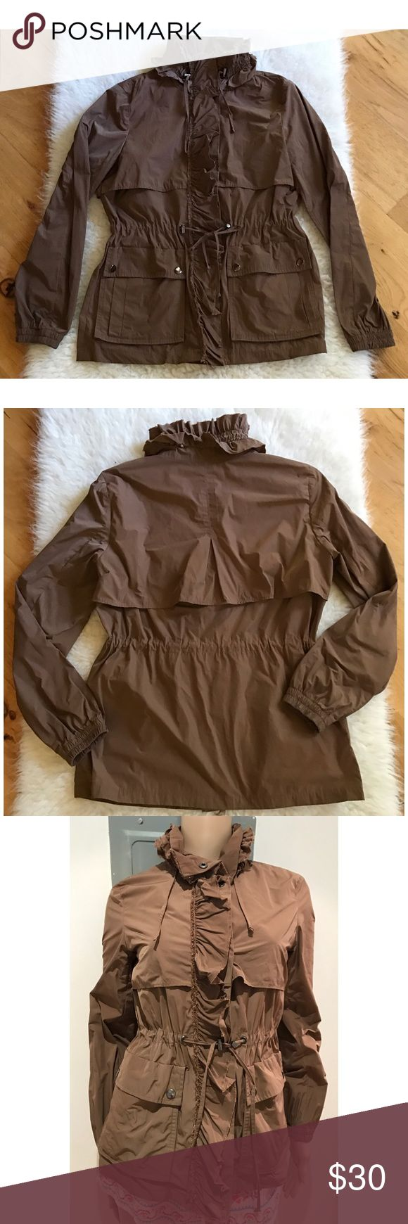 "EUC Banana Republic Ruffles Utility Parker Jacket Gorgeous dark brown Utility Parker jacket from Banana Republic in size x-small. Features adjustable high neck collar with Ruffles details, adjustable waist, pockets in front. No flaws. 100% polyester. Almost nylon sheen material to it. Much prettier in person. Color are truer to the first three pics above. Snap button closure. Measure about 25"" length, 18"" bust, 14"" shoulder to shoulder, 23"" sleeves. ❌No trades or modeling. Open to reasonable…"