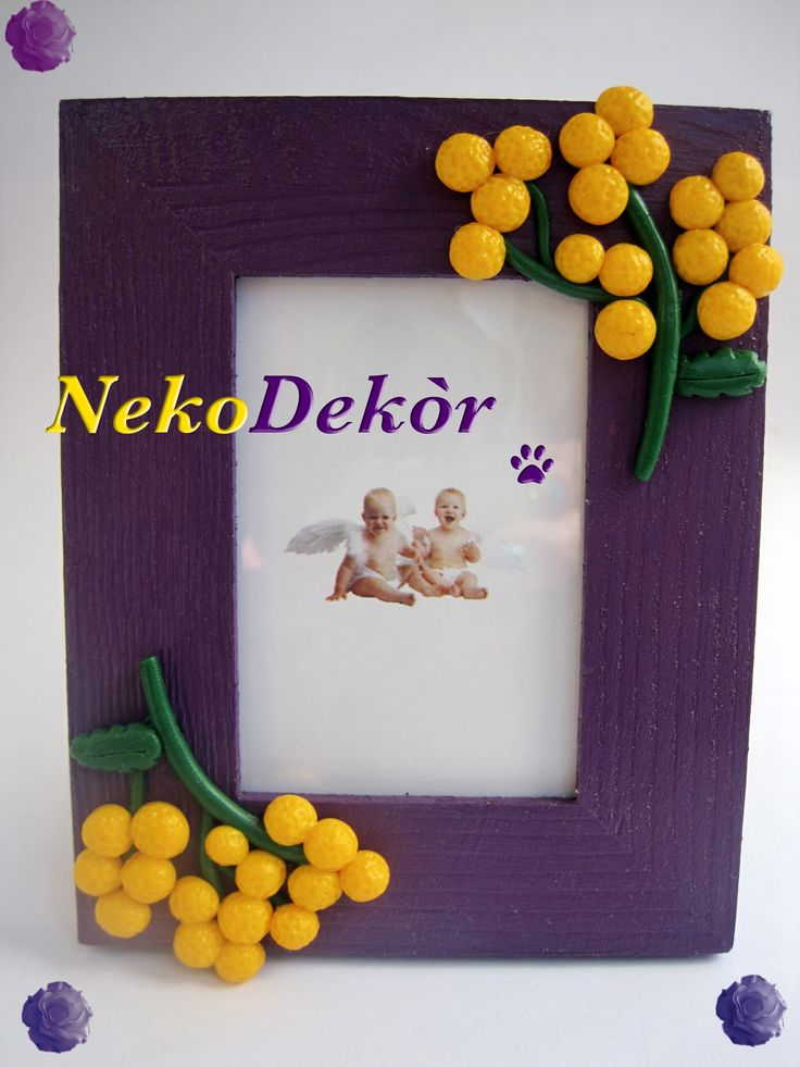 Wodden frame with fimo handmade mimosa flowers.