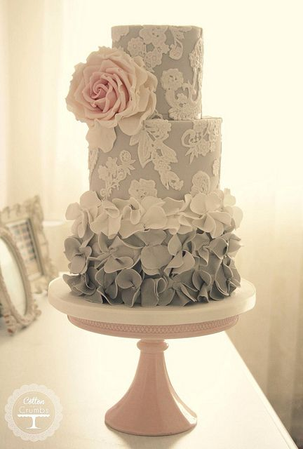 gray and white cake with pink flower