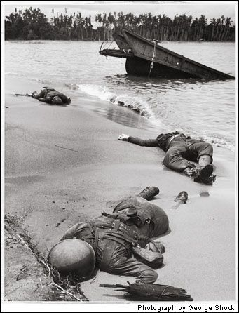 WWII Dead on the Beach 1943. LIFE ran this stark, haunting photograph of a beach in Papua New Guinea on September 20, 1943