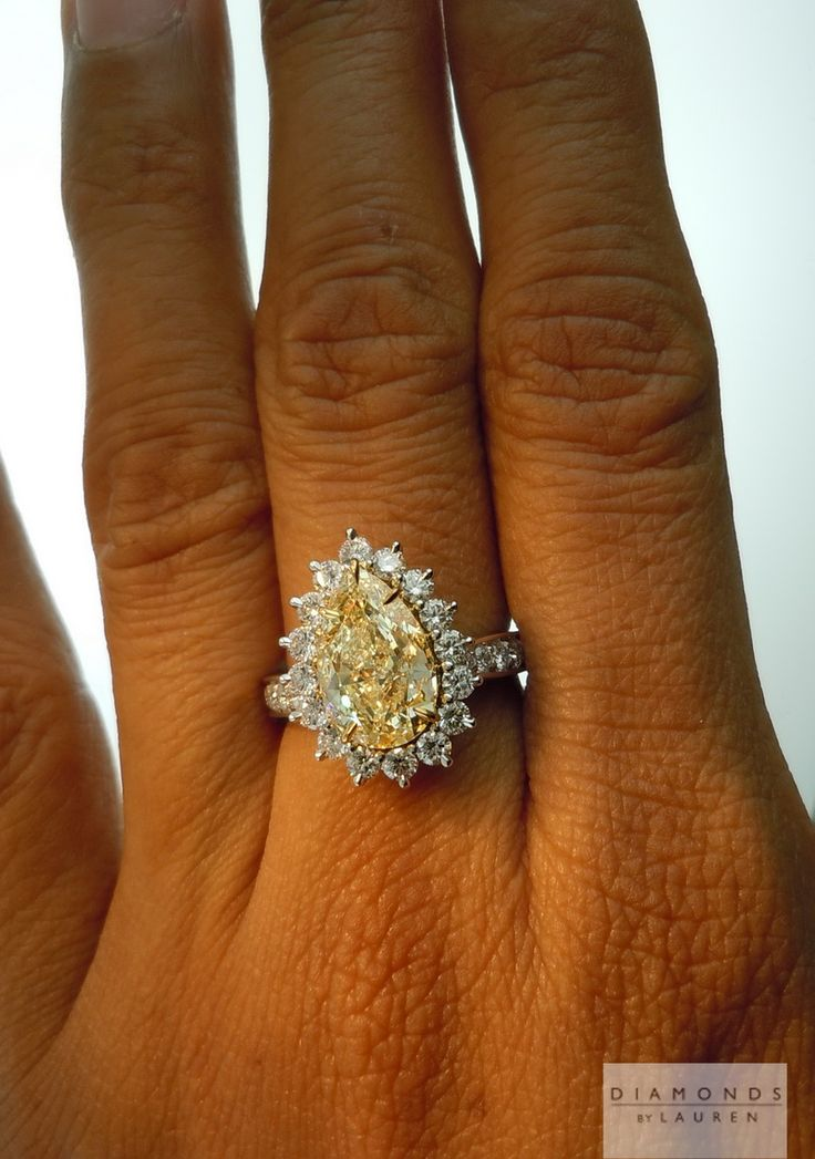 canary diamond ring. 3.31 ct VS2 natural light yellow center stone. 38 side stones, 1.26 ct total. diamondsbylauren.com. MUST HAVE.