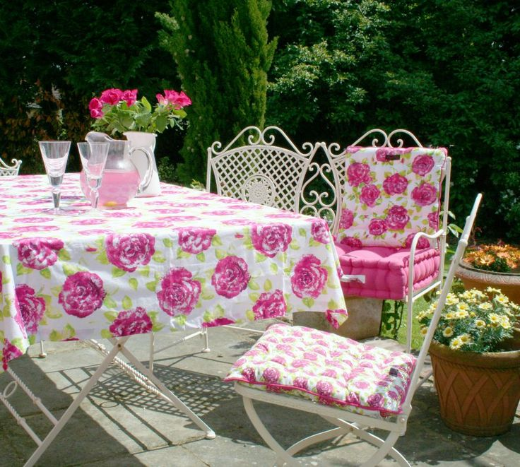 Let the Spring sprung and bring the colours outdoors. The best way for an al fresco dinning. Pink floral tablecloth, seat pads and cushions from Ragged Rose.