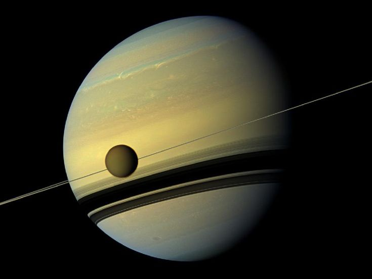 NASA's Cassini spacecraft took six images on May 6, 2012, to give us this natural-color portrait of Saturn. To give you some idea of the (ridiculous) scale of these objects, when Cassini took the pictures, it was about 483,000 miles away from Saturn's moon, Titan, which, at 3,200 miles across, is the planet's largest moon -- larger than the planet Mercury.