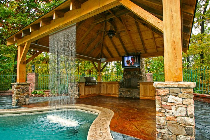 Rustic outdoor living. Waterfall with outdoor firepit, and BBQ! Wow! Just needs some furniture to go with. #OutdoorLiving #homes