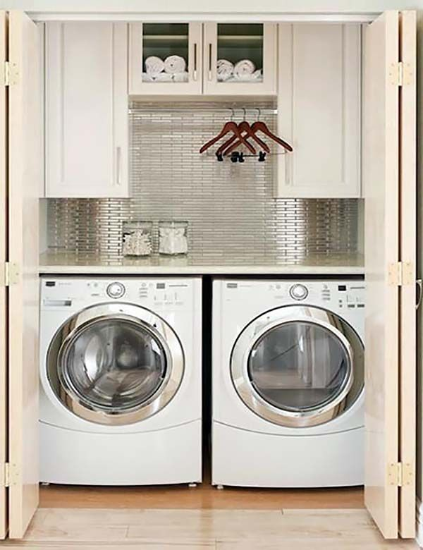 I  like this for laundry closet, although, I'd lose cabinets in middle and have hanging area taller.  Maybe only have one side of cabinet?