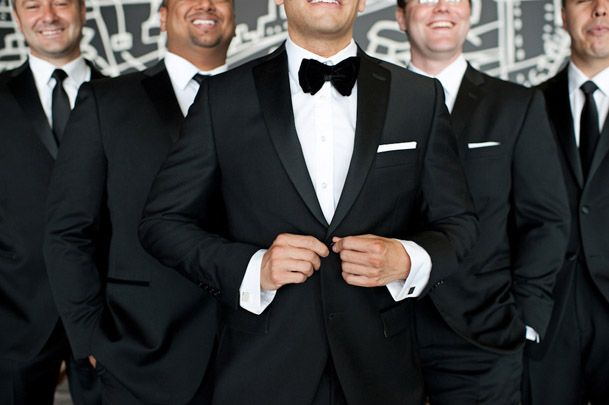 Classic black suits for the groom and groomsmen