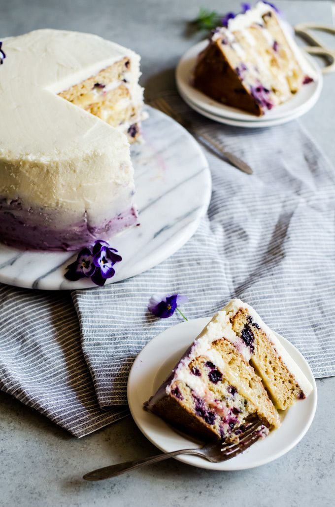 a delicious and beautiful lemon blueberry cake filled with lemon curd and frosting in ombre blueberry buttercream @cookiedesire