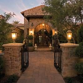 Mediterranean inspired home in Scottsdale: The Tuscan-style residence includes a grand   entry with patios on either side.