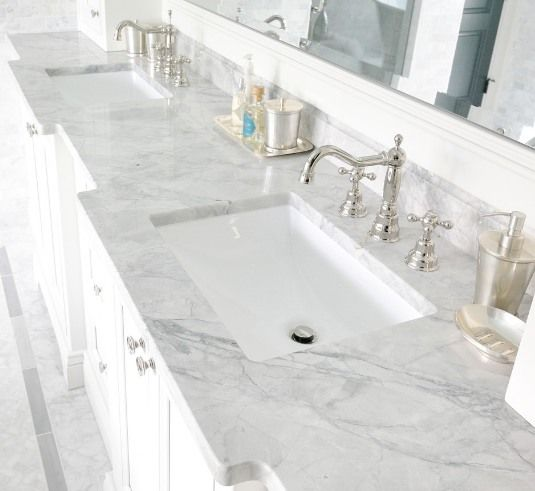 Bathroom vanity tops in White Macaubas quartzite by Levantina