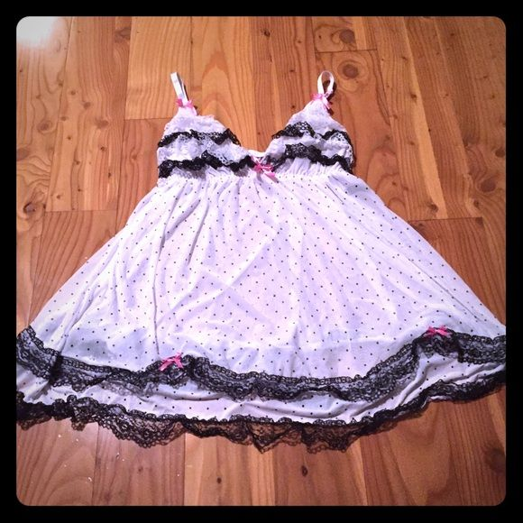 NWOT Babydoll Lingerie Dress Brand new without tags! White babydoll lingerie dress with ruffle details at the bottom and on the bust line. Adjustable spaghetti straps. No panties. Intimates & Sleepwear Chemises & Slips