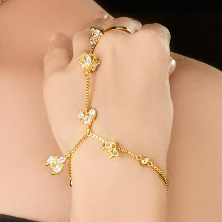 American Diamond Finger Ring Bracelet Is Embellished With Gold Chain