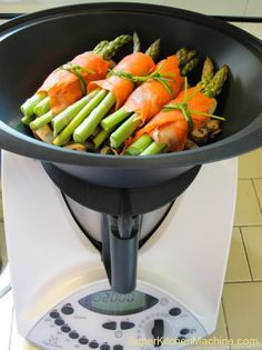 Salmon-wrapped asparagus bundlesare ready for steaming in the Thermomix Varoma.