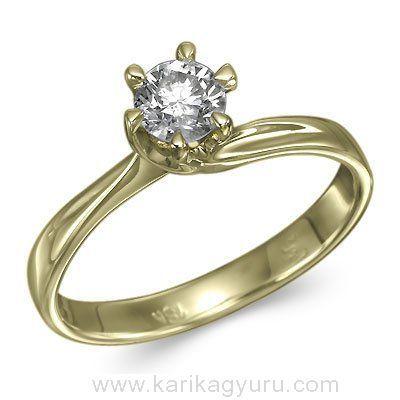 Karikagyűrű Áruház Klasszikus, csavart egy köves eljegyzési gyűrű kb. 2,3 gr aranyból. A hat karmos sárga arany foglalatban igény szerint 0,30ct-0,60ct súlyú briliánssal.